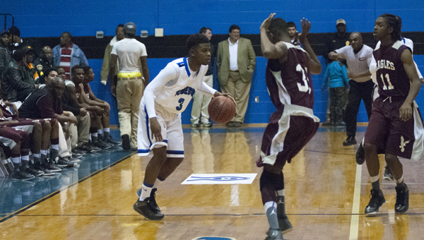 Kiante Jefferies looks to break down two A.L. Johnson defenders. Jefferies led the Tigers with 25 points Tuesday night.