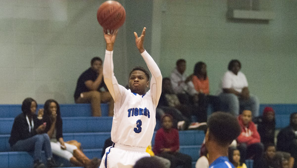 Kiante Jefferies takes a jumper against John Essex. Jefferies led the Tigers with 34 points in the win.