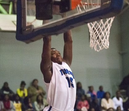 Cortez Lewis goes up for a dunk against John Essex.