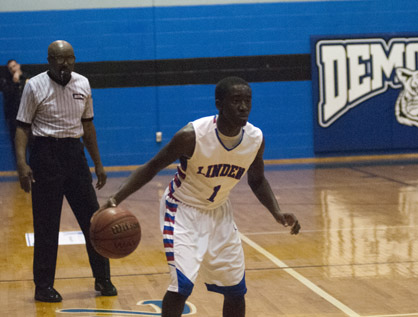 Dewayne Charleston brings the ball up the court for Linden against R.C. Hatch.