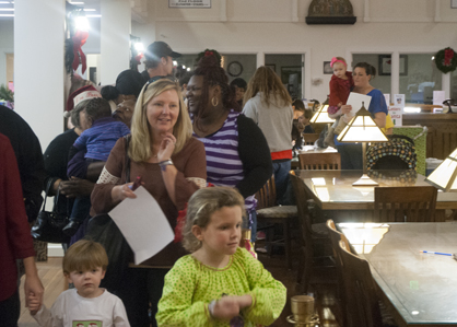 A large group of parents and children came to see Santa. More than 100 children were expected to come for the event.