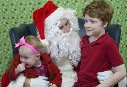 Abigail Williams (left) and Nathan Williams (right) visit with Santa.