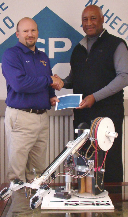 Georgia-Pacific Naheola Mill Manager Kelvin Hill presented Kevin Byrd, Sweet Water's science, technology, engineering and math teacher, with a $2,500 check to support the BEST Robotics team at the high school.