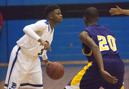 Kiante Jefferies directs teammates during their game against R.C. Hatch.