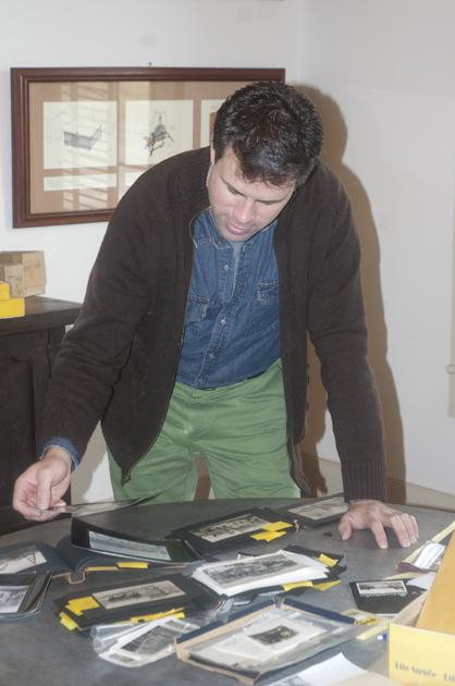 Kirk Brooker with the Marengo County Historical Society goes through some of Robert Hudson's photos.