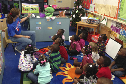 Demopolis First Baptist WEE School Director Cindy Hay reads to a class for the RIF program.