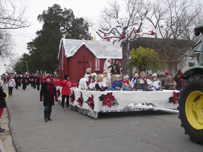 The winter season float was designed to look like St. Andrew's Episcopal Church, and Trinity Episcopal members were on the float.