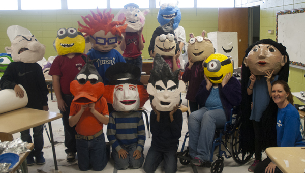 Students in the fifth-grade enrichment class at U.S. Jones Elementary School have been creating paper-mache heads since October for the Christmas on the River day parade.