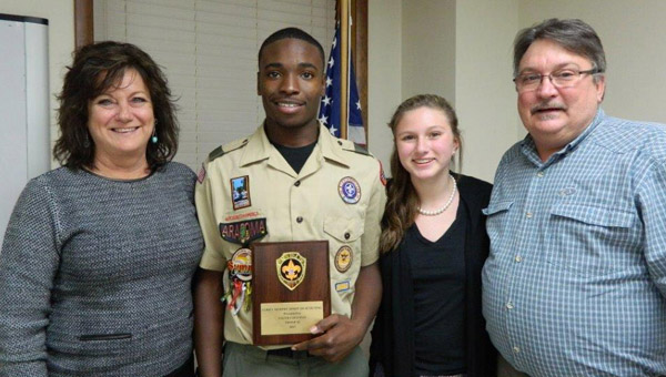 Tyler Coleman is the first recipient of the Corey Murphy Spirit of Scouting Award. He is pictured with Brian Murphy, Corey's father; Lyndsey Murphy, Corey's daughter; and Melanie York, Corey's mother.