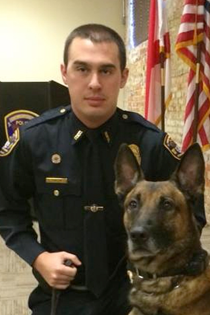 Demopolis officer Chase Courtney with K-9 Officer Bo, who was injured during an arrest Thursday and is being treated at a veterinarian's office.