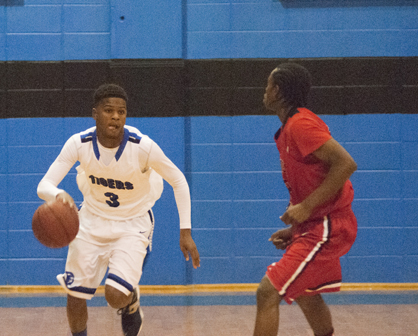 Kiante Jefferies brings the ball up the court for Demopolis against Sumter Central. He finished the game with 15 points to lead his team.