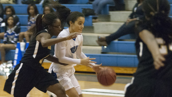 Sylvia Clayton drives to the basket against Greenville.