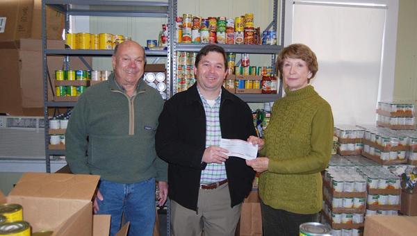 Wells with John and Bird Rish from the Demopolis Food Pantry.
