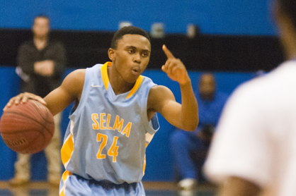 Alfred Robinson brings the ball up the court for Selma in their win Friday night over Demopolis.