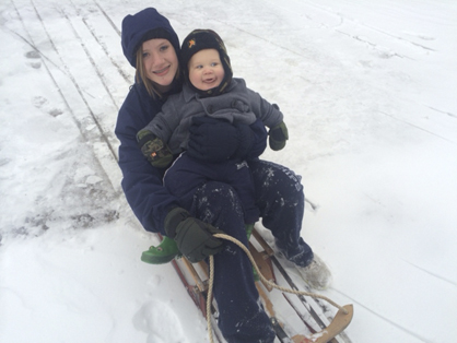 Madelyn Brooker escorting Andrew Thomasson on his first sled ride by the Demopolis Civic Center.