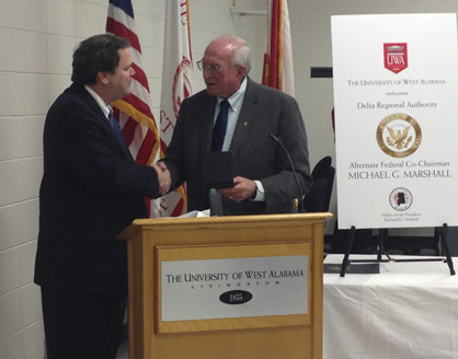 Delta Regional Authority Alternate Federal Co-Chairman Mike Marshall is greeted by UWA President Dr. Richard D. Holland.