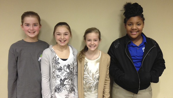 Shown from left to right are 4-H Club officers Alyse Dunklin, secretary; Charity Singleton, president; Abbie Hathcock, vice president; and Twyla Harris, reporter.