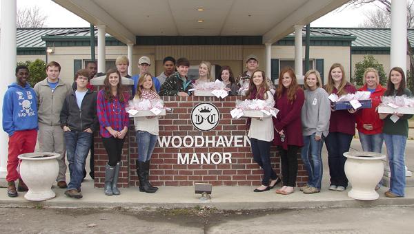 Shown are Demopolis High School DECA members at Woodhaven Manor.