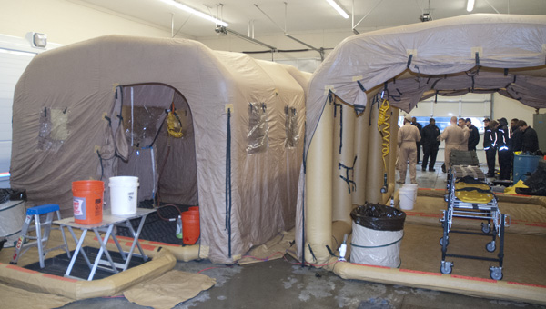 The 46th Civil Service Team set up their full decontamination system to demonstrate to the Demopolis Fire Department.
