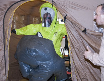 Members of the 46th Civil Service Team demonstrate how they do decontamination.
