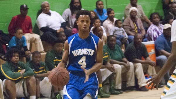 Timothy Jones attacks the lane for John Essex in the Class 1A, Area 4 championship game Monday night.