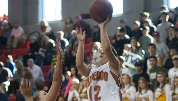 Chandler Stenz goes up for a layup in the Lady Longhorns' win over Sparta Academy on Thursday morning.