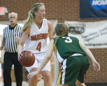 Andrea Edmonds brings the ball up the court and looks for a teammate.