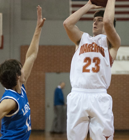 Carson Huckabee takes a jumpshot against Lakeside.