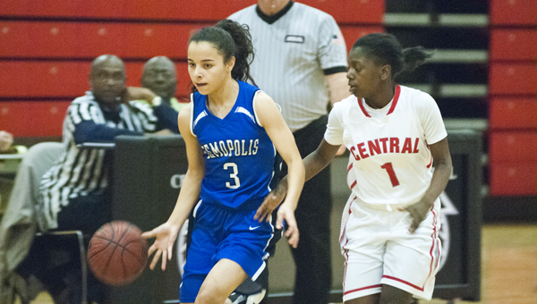Sylvia Clayton dribbles down the court for Demopolis with Central's Jada Prewitt in pursuit.