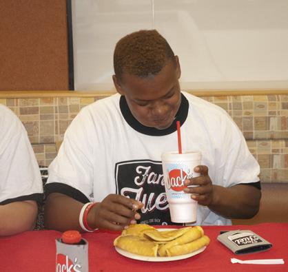 Davontae May struggles with his pancakes.