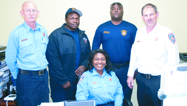 ONE OF THE GUYS: Shown from left are Lt. James Day, Lt. Alex Morris, Lt. Meg James, Vanessa Watson and Chief Tommy Tate.