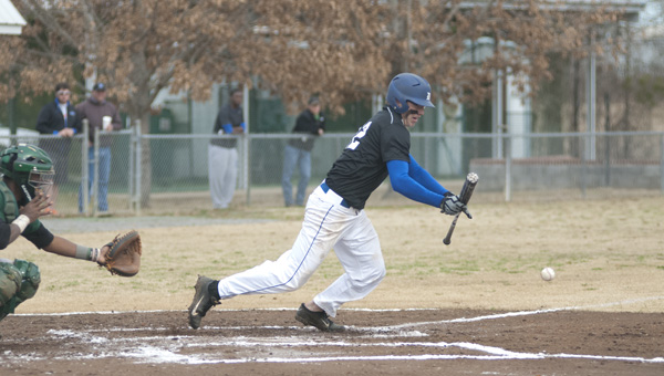 Michael Brooker lays down a bunt for Demopolis against Dallas County.