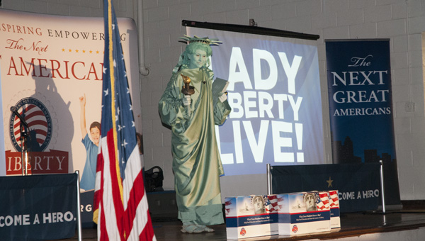Lady Liberty visited U.S. Jones Elementary to introduce students to the Super Citizen Program.