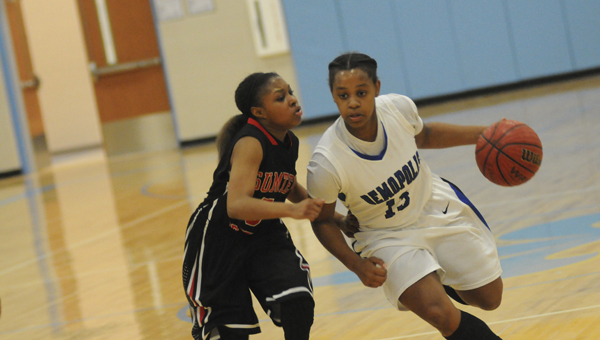 Lady Tiger DeeDee White dribbles around a defender during Demopolis' 49-48 win over Sumter Central in the Class 5A, Area 6 semi-finals. With the win, Demopolis moves on to face Selma in the area finals.