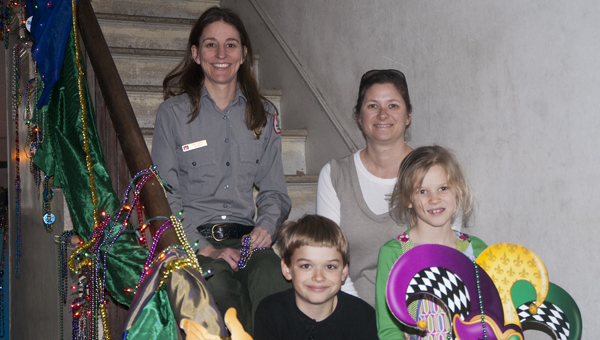 Anne Cross and Amanda Smith with the Marengo County Historical Society, along with Cooper and Sarah Beth Smith, helped decorate Lyon Hall for the Mardi Gras Masquerade.