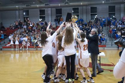 Marengo Academy girls hoist trophy
