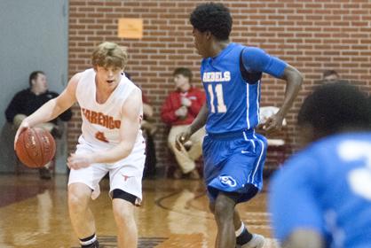Hayden Huckabee brings the ball up the court.