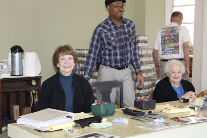 Shown working a recent Wednesday at the Demopolis Food Pantry are Byrd Rish, the Rev. Frank Stiff, Biboo Webb and Thomas Melton.