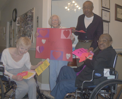 Shown are Karen Kincaid, Trice Smith, Bill Johnson and Josephine Johnson from Southern Oaks Assisted Living receiving Valentine's Day cards made by local students.