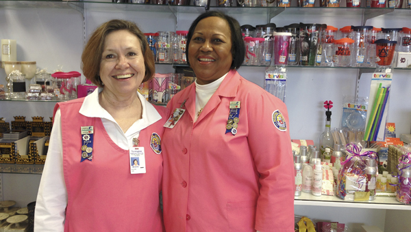 """PINK LADIES: Shown are BWWMH auxiliary members Brenda and Johnnie Knott. The auxiliary was sometimes called """"the Pink Ladies"""" early on but today has male and female members."""