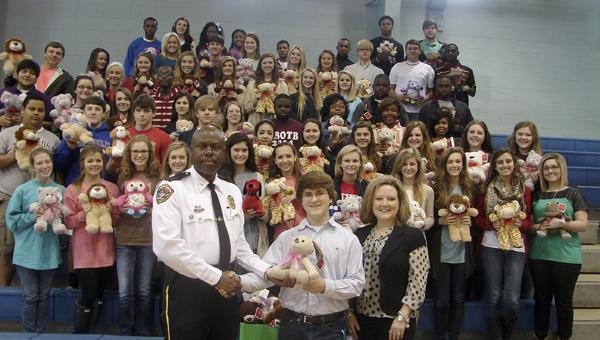 Demopolis DECA chapter members with Demopolis Police Chief Tommie Reese.