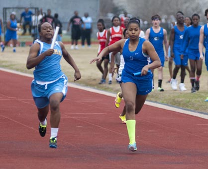 Ivery Moore (right) helped the Demopolis girls 4x100 relay team to a third-place finish.