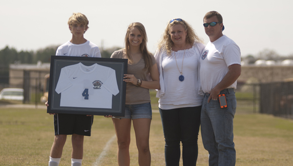 The Demopolis High School soccer program retired the jersey of Cody Webb and dedicated it to his family. Shown, from left, are Gavin, Victoria, Jami and Freddi Webb.