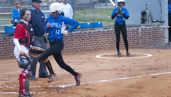 Courtney Smith comes across the plate for Demopolis in the first inning of their game against ACA.