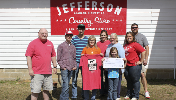 Shown left to right at the Jefferson Country Store are George Patterson, Bigbee Humane Society volunteers Dakota Cunningham, Tommy Hewitt, Cindy McDonald, Donna McPherson and Martha Ellis, with Jefferson Country Store owners Betsy Compton, Tony Luker and Mary Sam Luker (holding check). Not pictured is Store Dog.