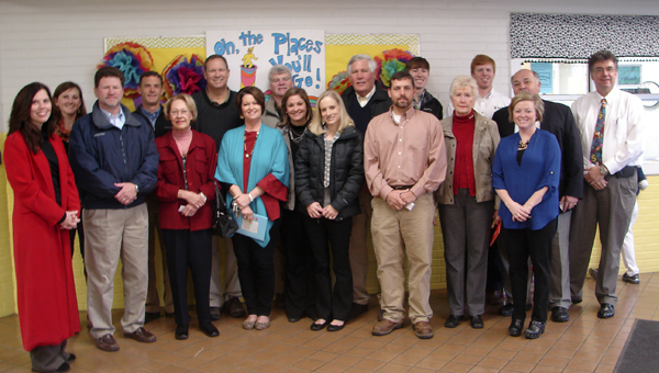 Shown are business and civic leaders who read to students at Westside Elementary School on Monday morning.