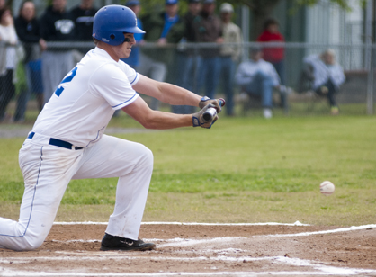 John Anthony Morrison attempts to lay down a bunt against Benjamin Russell on Friday night.