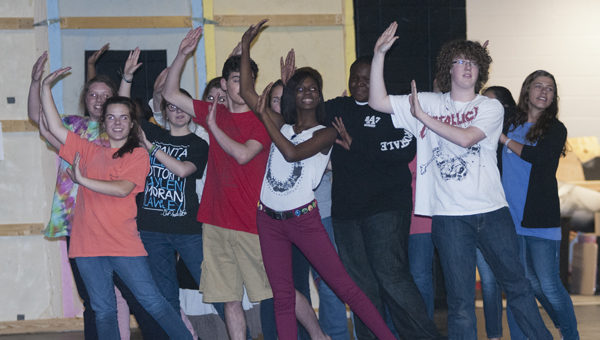 Members of the Thoroughly Modern Millie cast practice for the April 10-13 show.