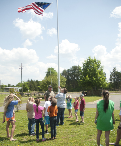 Marengo County Rangers 4-H Club members raise the American Flag at Foscue Park.