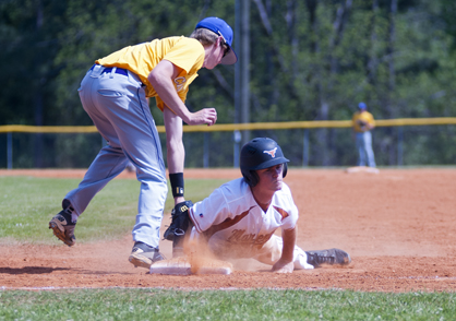 Wyatt Hale slides back into first base after a pick-off attempt from Cornerstone.